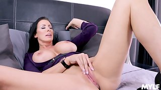 Reagan Foxx masturbates using her masterful fingers on the resemble closely