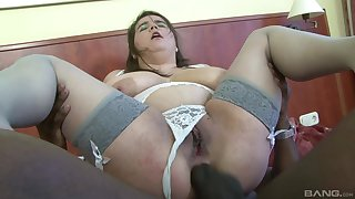 Chubby mature Deborah sucks a black dick and rides it with regard to her asshole